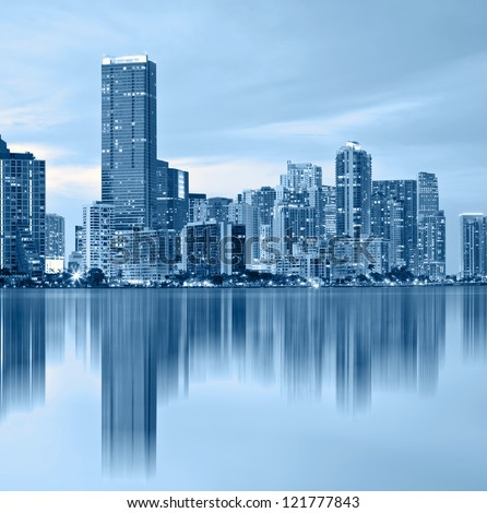Miami Florida, downtown buildings, blue color processed photo with reflections in the Biscayne Bay water - stock photo