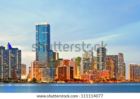 Miami Florida sunset over downtown illuminated business and luxury residential buildings and hotels. Cityscape of World famous travel location. - stock photo