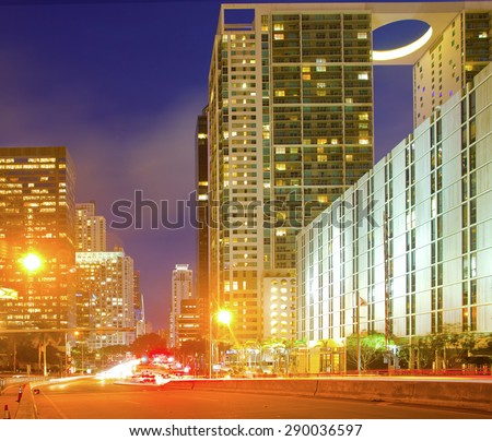 Miami Florida USA, famous travel destination, downtown modern illuminated buildings at night with moving traffic - stock photo