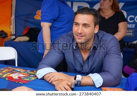 Miami, Florida, USA- March 7, 2015: News reporter, Bobby Brooks, greets fans at the Carnaval On The Mile Festival in Miami, Florida - stock photo