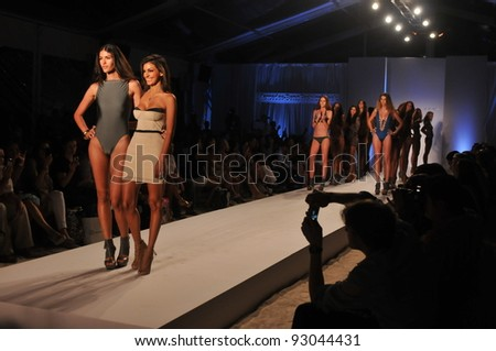 MIAMI - JULY 18: Designer Sonia Vera and models walks runway at the Sonia Vera Collection for Spring/ Summer 2012 during Mercedes-Benz Swim Fashion Week on July 18, 2011 in Miami, FL - stock photo
