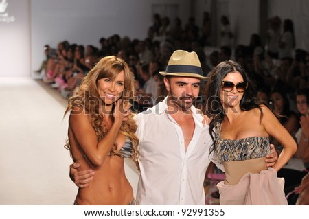 MIAMI - JULY 18: (L-R) Aylin Mujica, Designer A.Z. Araujo and Adriana de Moura walk the runway at the A.Z Araujo show during Mercedes-Benz Fashion Week Swim at Raleigh on July 18, 2011 in Miami, FL - stock photo