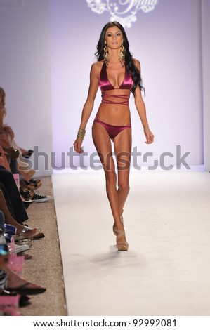 MIAMI - JULY 18: Model walking runway at the Have Faith Collection for Spring/ Summer 2012 during Mercedes-Benz Swim Fashion Week on July 18, 2011 in Miami, FL - stock photo