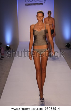 MIAMI - JULY 18: Model walking runway at the Kooey Swimwear Collection for Spring/ Summer 2012 during Mercedes-Benz Swim Fashion Week on July 18, 2011 in Miami, FL - stock photo