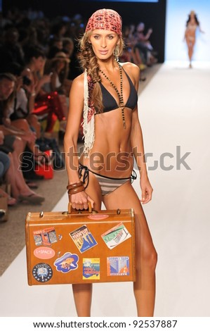 MIAMI - JULY 14: Model walks runway at the L Space Swimsuit Collection for Spring/ Summer 2012 during Mercedes-Benz Swim Fashion Week on July 14, 2011 in Miami, FL - stock photo