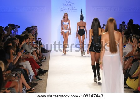 MIAMI - JULY 19: Model walks runway at the Lisa Blue Collection for Spring/ Summer 2013 during Mercedes-Benz Swim Fashion Week on July 19, 2012 in Miami, FL - stock photo