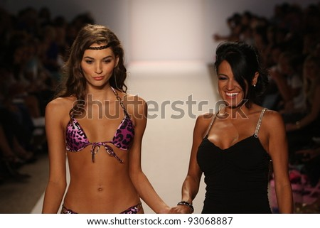 MIAMI - JULY 18: Model walks runway at the Perfect Tan Bikini Collection for Spring/ Summer 2012 during Mercedes-Benz Swim Fashion Week on July 18, 2011 in Miami, FL - stock photo