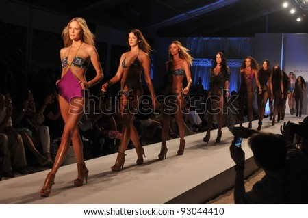 MIAMI - JULY 18: Models walks runway finale at the Sonia Vera Collection for Spring/ Summer 2012 during Mercedes-Benz Swim Fashion Week on July 18, 2011 in Miami, FL - stock photo