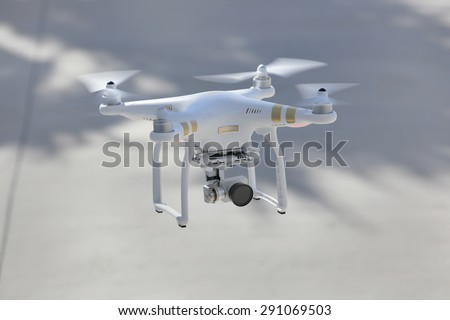 MIAMI - JUNE 19: Image of the phantom 3 professional quadcopter which shoots 4k video and 12mp still images and is controlled by wireless remote with a range of over 2km June 19, 2015 in Miami FL - stock photo