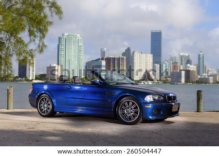 MIAMI - MARCH 11: Stock image of a 2006 BMW M3 convertable with the top down shot with Brickell Miami in the background MArch 11, 2015 in Miami FL - stock photo