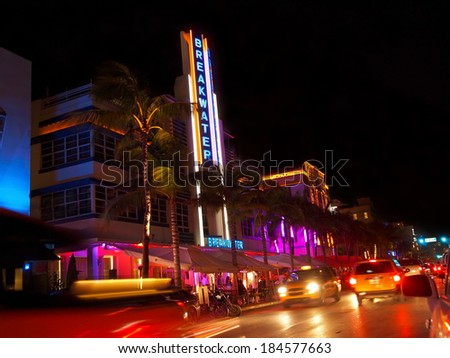 MIAMI - November 12, 2012: The Breakwater hotel on Ocean Drive in South Beach, after dark, on November 12, 2012, in Miami, Florida. - stock photo