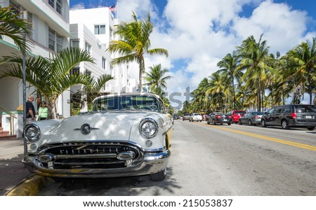 Miami, Ocean drive, Fl. December 11 2013. The famous street Ocean drive. It is known for its Art Deco hotels. Ocean Drive is also the location of the famed Versace mansion - stock photo