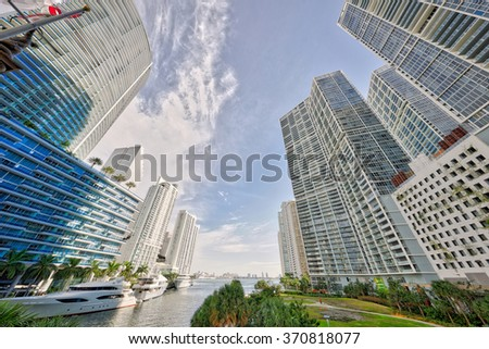 Miami River wide angle with highrise buildings - stock photo
