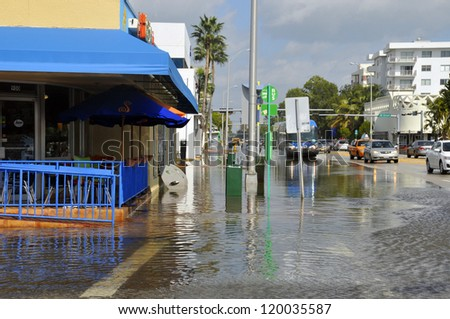 MIAMI - SOUTH BEACH - FLORIDA, OCTOBER 28: Miami South beach Lenox Ave flood aftermath of Hurricane Sandy on october 28 2012 in Miami South Beach. - stock photo