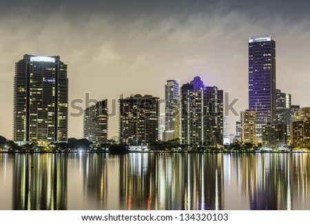 Miami sunset over downtown illuminated business and luxury residential buildings in Florida - stock photo