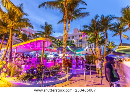 MIAMI, USA - AUG 3, 2013: Night life in te clevelander bar at Ocean drive in Miami, USA. Night-Life in South Beach  is one of the main tourist attractions in Miami. - stock photo