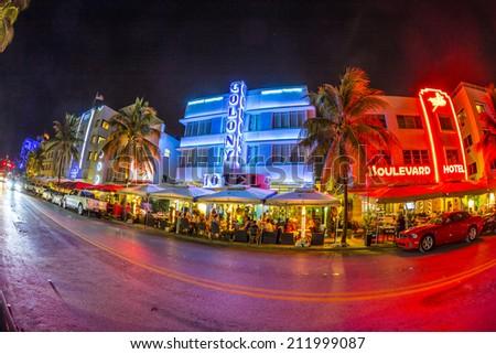 MIAMI, USA - AUG 19, 2014: Ocean drive buildings in Art deco style in Miami, USA. Art Deco district architecture is one of the main tourist attractions in Miami. - stock photo