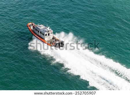 MIAMI, USA - SEPTEMBER 06, 2014 : Coast guard boat near Miami port on September 06, 2014 in Miami. - stock photo