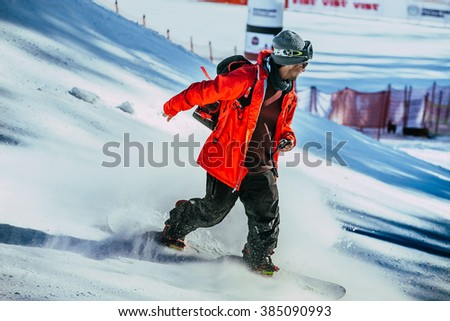 Miass, Russia - February 20, 2016: man judge snowboard competition coming down mountain during Snowboard World Cup - Snowboard Cross - stock photo