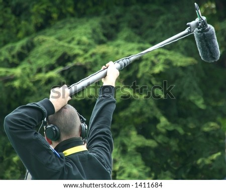 Mic. operator in a park - stock photo