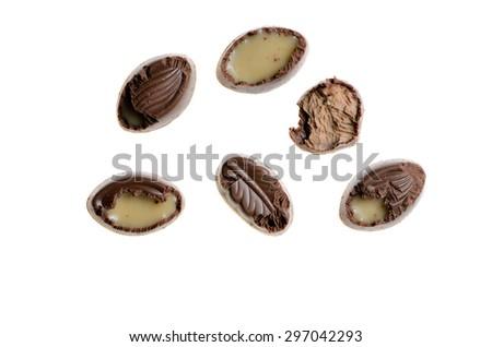 mice bitten chocolate candy on isolate - stock photo
