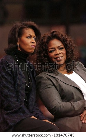 Michelle Obama, Oprah Winfrey attending Barack Obama Campaign Rally for Democratic Presidential Primary with Oprah Winfrey, The Verizon Wireless Arena, Manchester, NH, December 09, 2007 - stock photo