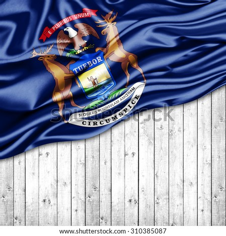 Michigan flag of silk with copyspace for your text or images and wood background - stock photo