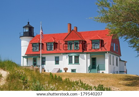 Michigan's Point Betsie Lighthouse overlooks Lake Michigan and marks the southern end of the Manitou Passage. - stock photo