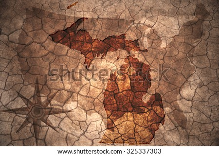 Michigan state map on vintage usa map, crack paper background - stock photo