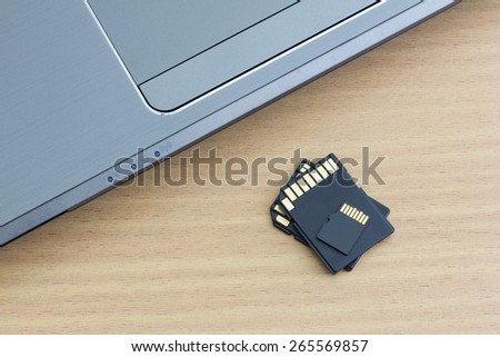 micro sd card and adapter with laptop - stock photo