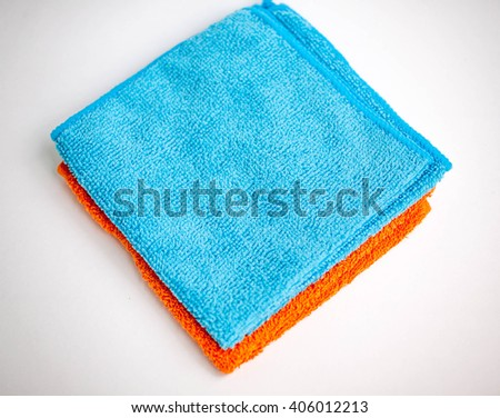 Microfiber towel for car wipe. Blue and orange microfiber cloth isolated on white background - stock photo