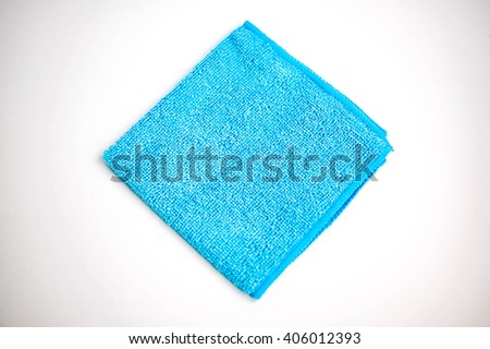 Microfiber towel for car wipe. Blue microfiber cloth isolated on white background - stock photo