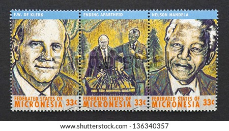 MICRONESIA - CIRCA 2000: three postage stamps printed in Micronesia showing images of Nobel Peace prize winners Nelson Mandela and Frederick Willem De Klerk, circa 2000. - stock photo