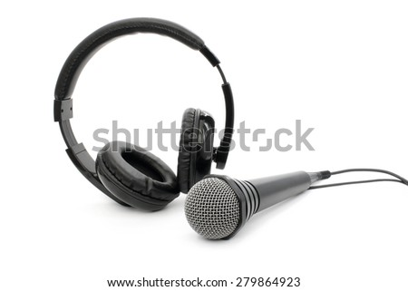 Microphone and headphones with wires on white background - stock photo