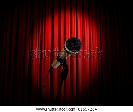 microphone and red curtain - stock photo