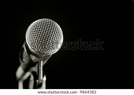 microphone close-up on black - stock photo