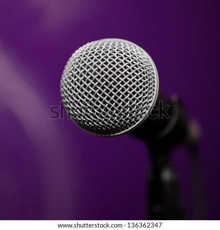 Microphone closeup on blurred background - stock photo