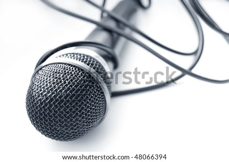 Microphone conceptual image. Approximation of isolated microphone. - stock photo