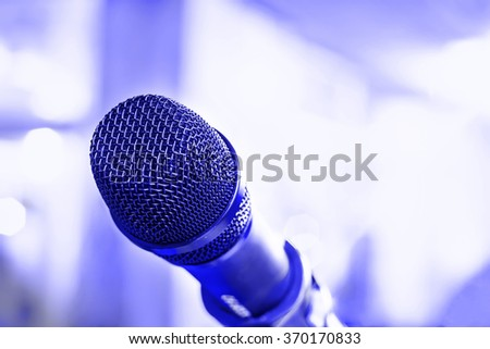 Microphone for sound, music, karaoke in audio studio or stage. Mic technology. Voice, concert entertainment background. Speech broadcast equipment. Live pop, rock musical performance.  - stock photo