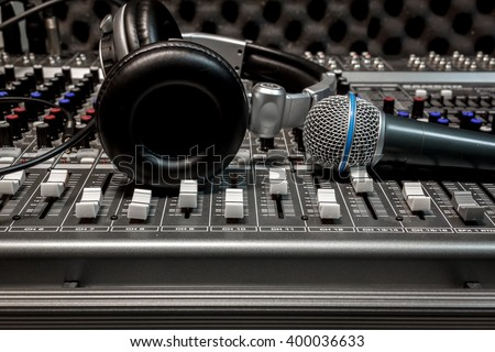 microphone,headphone on sound mixer music background. - stock photo