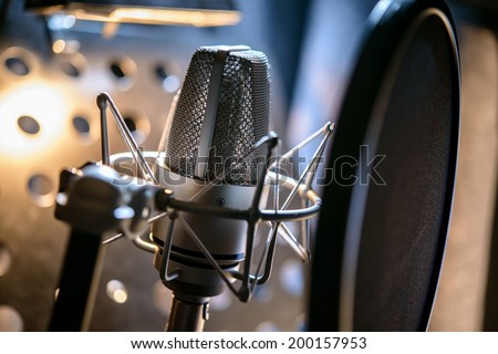 Microphone in a recording studio - stock photo