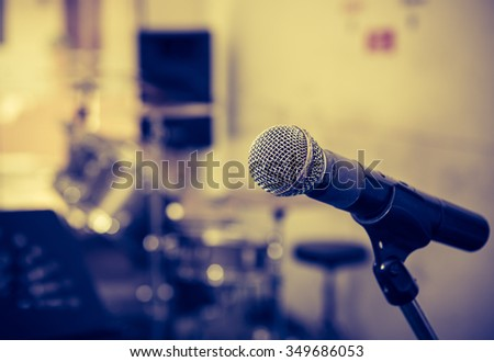 Microphone in a recording studio with out of focus background : Vintage tone style - stock photo