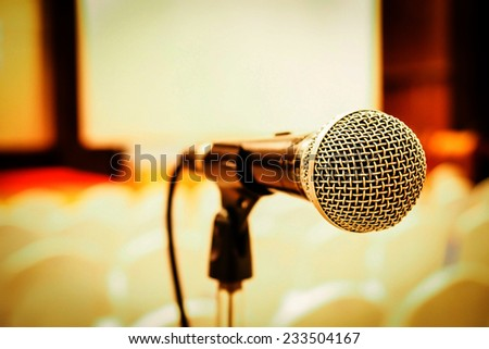 Microphone in concert hall or conference room . Right side - stock photo