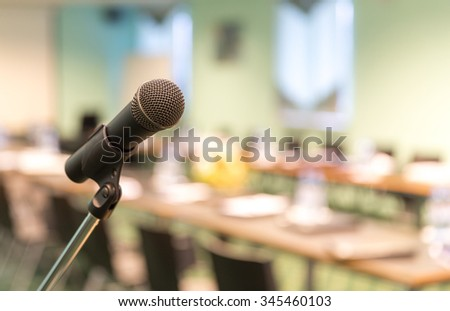 Microphone in conference hall before business meeting - stock photo