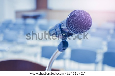 Microphone in conference room, with cool tone - stock photo