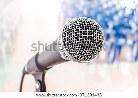 microphone in meeting room background - stock photo