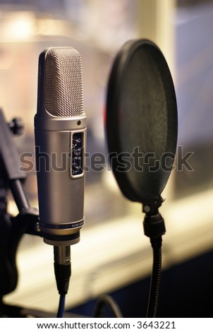 Microphone in small broadcasting station - stock photo