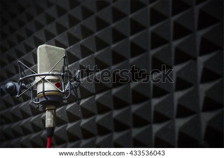 microphone in the studio with acoustic panels - stock photo