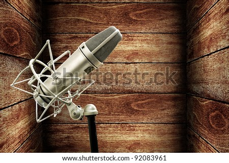 Microphone in wooden box, Music studio concept - stock photo