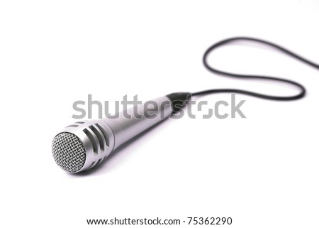 Microphone, isolated, with cord. Selective focus on the front mesh - stock photo